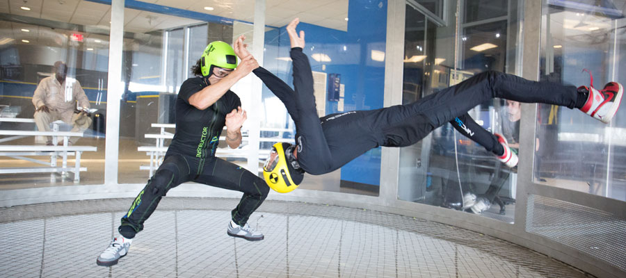 Skydivers improving their skills in the wind tunnel.