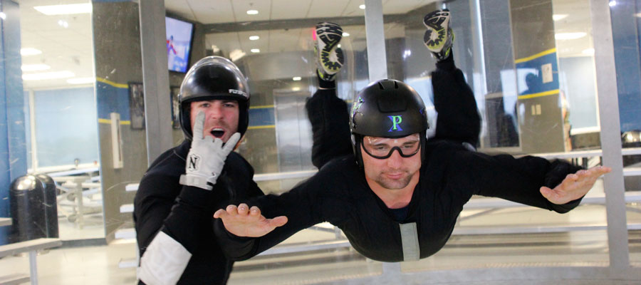 Learning to fly in a wind tunnel