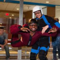 A gentleman flies in the tunnel as part of Paraclete's team building activities - indoor skydiving.