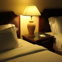 Night scene image of comfortable pillows and bed, Hotel room Int