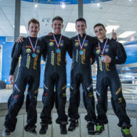 World Champions Hayabusa celebrate with their gold medals after the Indoor Skydiving Raeford NC tunnel Championships