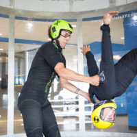 A member flies with one of the indoor skydiving raeford nc coaches