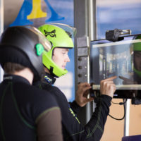 staff operating indoor skydiving equipment