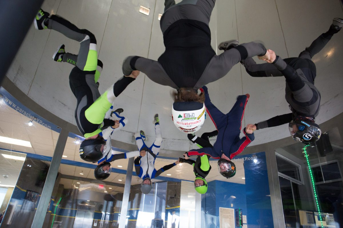 skydiving team trains in indoor skydiving wind tunnel