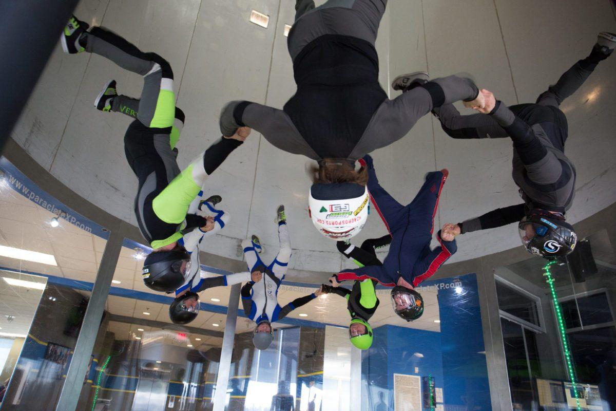 skydiving team trains in indoor skydiving wind tunnel