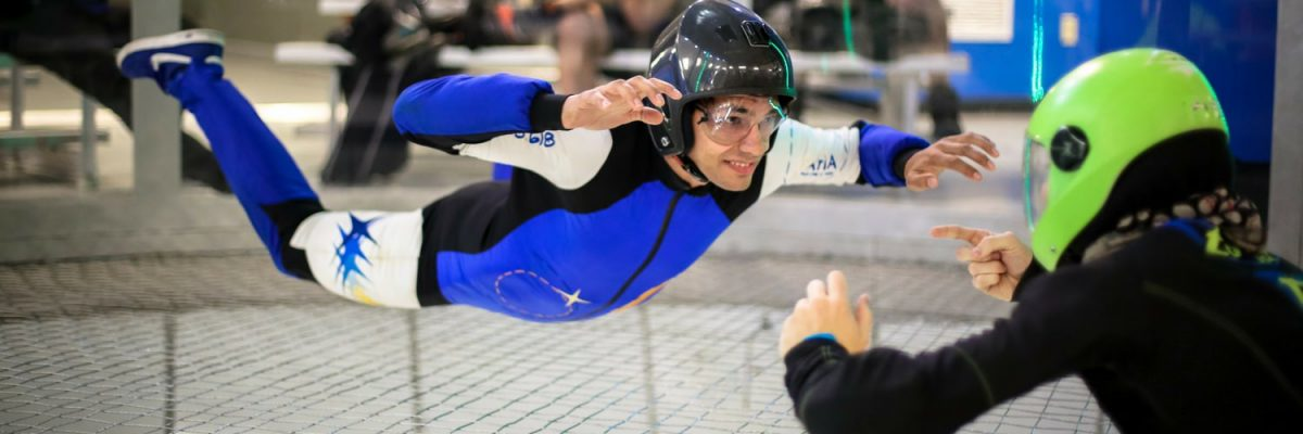 indoor skydiving beginner with instructor