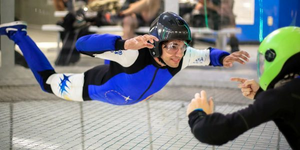 indoor skydiving beginner with instructor