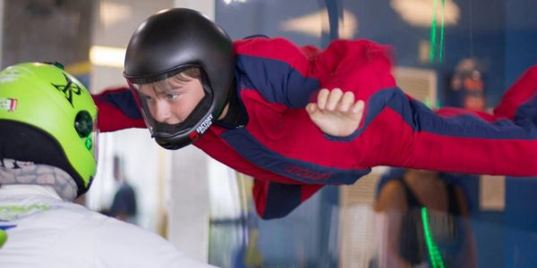 young boy learning how to indoor skydive