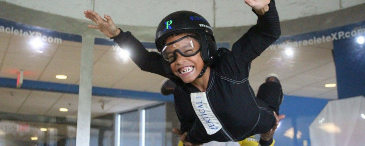 young kid flies in indoor skydiving wind tunnel