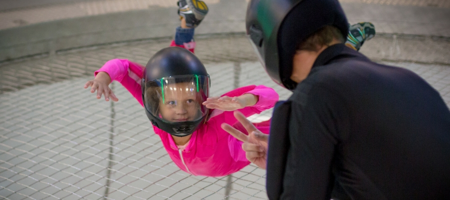 young indoor skydiving party guest takes flight