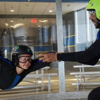 young first time flier at indoor skydiving party