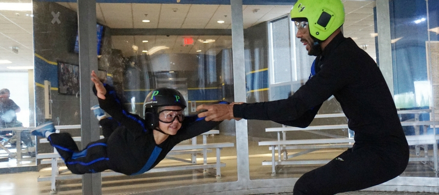 young flier at indoor skydiving party