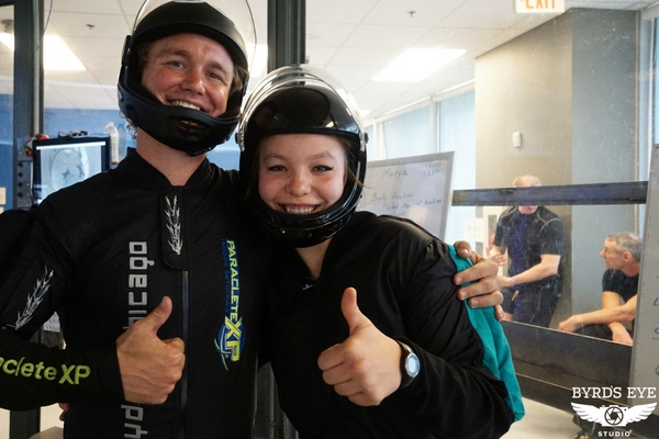 woman with skydiving instructor enjoying tunnel camp