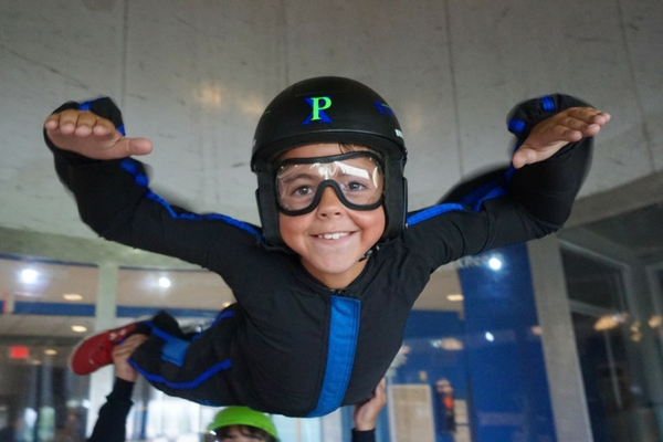 young boy indoor skydiving