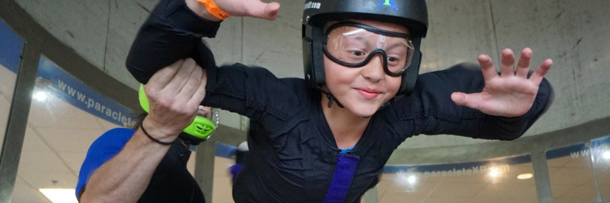 young boy bravely attempts first indoor skydive