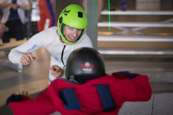 young indoor skydiver gets coaching
