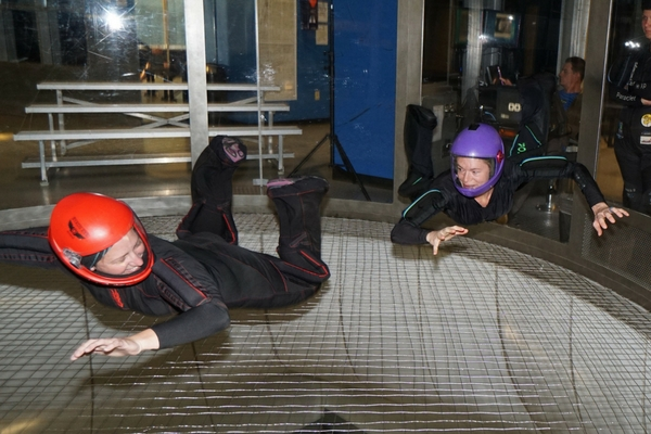 two fit women train in wind tunnel