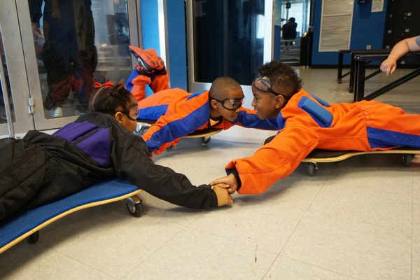 young kids training for bodyflight in wind tunnel