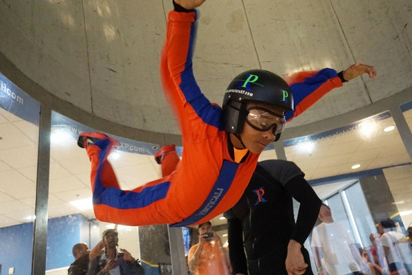young child flies in the wind tunnel