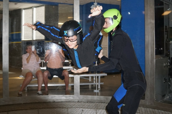 young child tries indoor skydiving first time