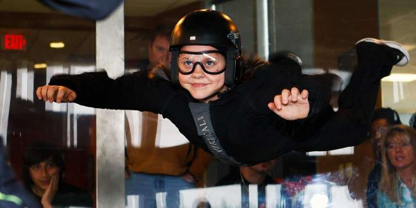 young girl tries wind tunnel skydiving first time