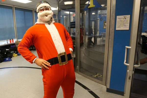 santa standing outside of paraclete indoor skydiving tunnel