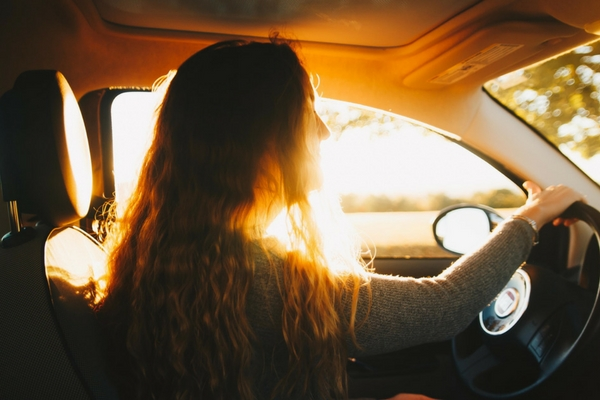 woman at the wheel on a road trip