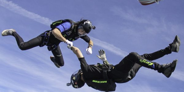 Mike Brewer and team member exits a skydiving plane