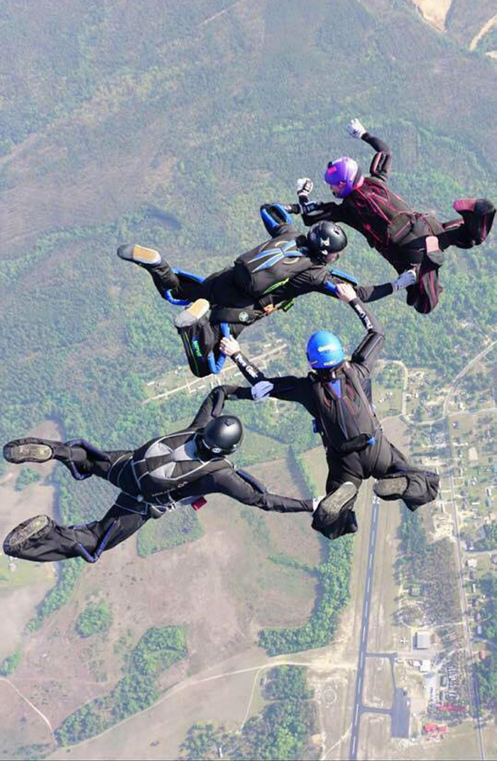 Steve Rulli flies a 4-way skydiving formation