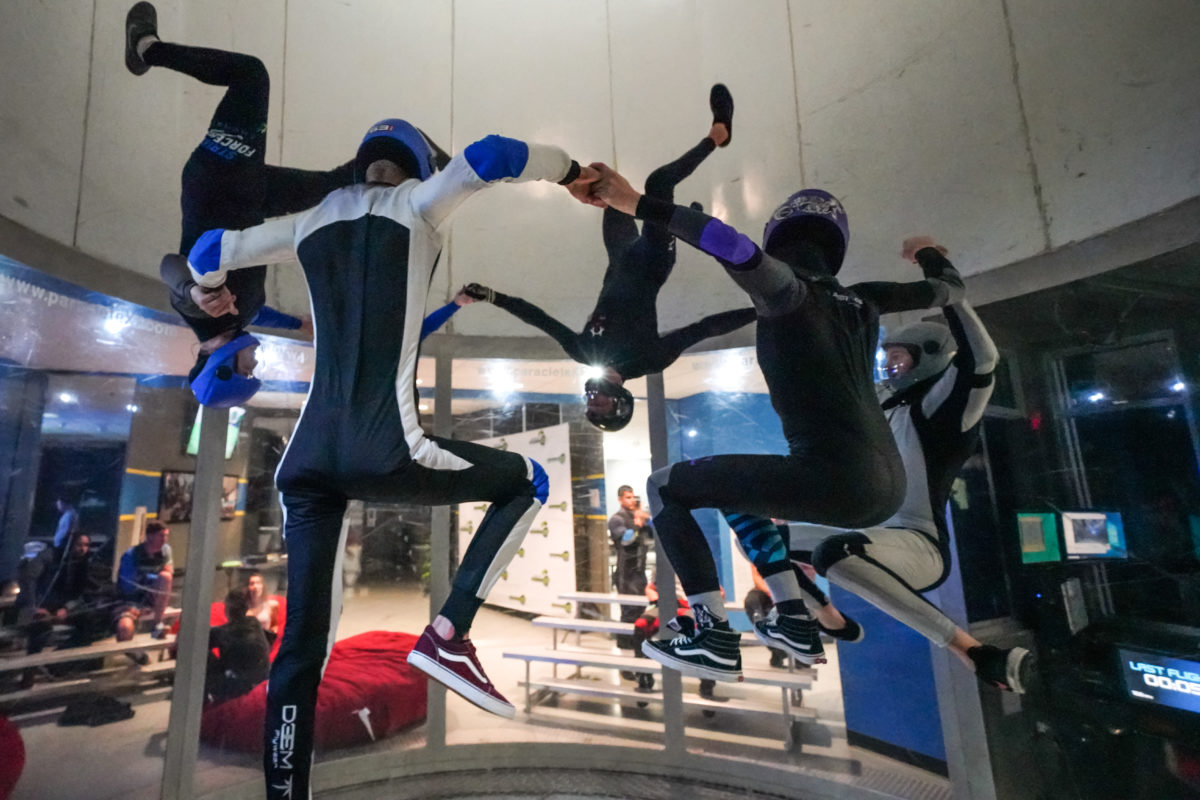 A group of indoor skydivers in the wind tunnel.